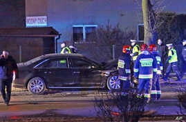 Police and fire brigade officers inspect Polish Prime Minister's Beata Szydlo's car after an accident in Oswiecim, Poland, Feb. 10, 2017.