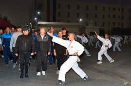 In this Dec. 16, 2018 photo released by the Egyptian Presidency, Egyptian President Abdel-Fattah el-Sissi inspects cadets during their morning exercises at the national Military Academy, in a suburb of Cairo, Egypt.