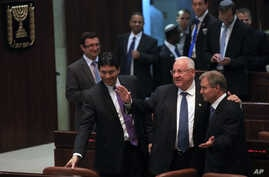 Israel's parliament has chosen Reuven Rivlin, second from right, a stalwart in the ruling Likud Party, as the country's next president, in Jerusalem, June, 10, 2014.