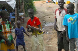 FILE - A group of children at the U.N. protection of Civilians site in Juba, South Sudan, play with a toy gun. One of four armed groups in Sudan, the Sudan People's Liberation Movement-North (SPLM-N), has agreed to end and prevent the recruitment and