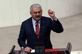 Prime Minister Binali Yildirim speaks after Turkey's parliament approved a contentious constitutional reform package, paving the way for a referendum on a presidential system that would greatly expand the powers of President Recep Tayyip Erdogan's of