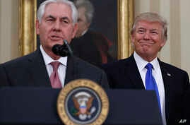 President Donald Trump smiles at Secretary of State Rex Tillerson after he was sworn in in the Oval Office of the White House in Washington, Feb. 1, 2017.