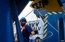 Steven Benjamin, a contractor with Phoenix International Incorporated, rigs a guideline through the tow pinger locater 25 (TPL 25) aboard USNS Apache (T-ATF 172). USNS Apache departed Norfolk, Virginia, on Oct. 19 to begin searching for wreckage from