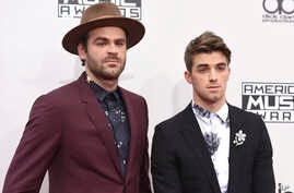 Alex Pall, left, and Andrew Taggart, of The Chainsmokers, arrive at the American Music Awards at the Microsoft Theater in Los Angeles.