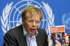 World Health Organization Assistant Director General Bruce Aylward holds a report during a news conference on Ebola at the United Nations in Geneva, Sept. 16, 2014.
