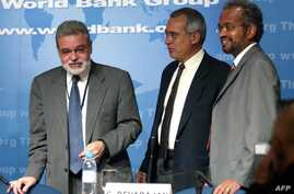 World Bank official Nicholas Stern (C), Jean-Louis Sarbib (L), and Shanta Devarajan (R), at the Dubai Annual Meeting of Board of Governors, World Bank Group and International Monetary Fund September 21, 2003.