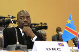 FILE - DRC President Joseph Kabila is seen at a summit in Uganda's capital, Kampala.