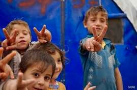 A handful of Mosul children engage with reporters. (J. Dettmer/VOA)