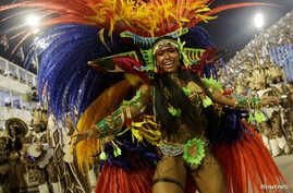 Drum queen Raissa from Beija-Flor samba school performs during the carnival parade at the Sambadrome in Rio de Janeiro, Brazil Feb. 27, 2017.