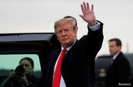 U.S. President Donald Trump waves as he arrives at Akron-Canton airport in Canton, Ohio, March 20, 2019.