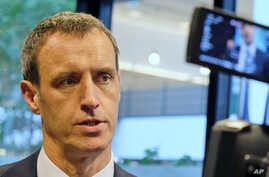 Europol Director Rob Wainwright answers questions of reporters in The Hague, Netherlands, Feb. 22, 2016.