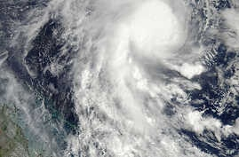 This image from NASA's Aqua satellite and made available by NASA's Goddard MODIS Rapid Response Team shows Cyclone Marcia in the Coral Sea, off the northeast coast of Australia, Feb. 18, 2015.