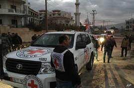 This picture provided by The International Committee of the Red Cross, working alongside the Syrian Arab Red Crescent (SARC) and the United Nations, shows a convoy containing food, medical items, blankets and other materials being delivered to the to