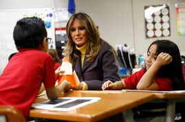 First lady Melania Trump visits with students in a classroom at Dove School of Discovery in Tulsa, Oklahoma, March 4, 2019, during a two-day, three-state swing to promote her Be Best campaign.