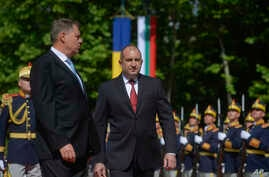 Bulgaria's President Rumen Radev, right, attends a welcoming ceremony with Romanian counterpart Klaus Iohannis at the Cotroceni Presidential Palace in Bucharest, Romania, June 28, 2017.