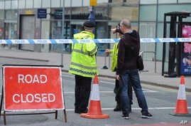 Police block a road near to the Manchester Arena in central Manchester, England, May 23, 2017. An explosion struck an Ariana Grande concert attended by thousands of young music fans in northern England late Monday, killing over a dozen people and inj