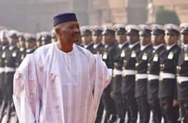 FILE - Malian President Amadou Toumani Toure inspects an honor guard during a ceremonial reception at the Presidential Palace in New Delhi, India, Jan. 11, 2012. Mali's National Assembly rejected plans to try Toure on treason charges on Saturday.