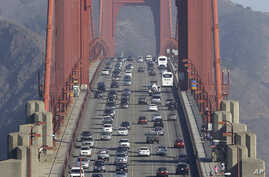 FILE - Automobile traffic flows over the Golden Gate Bridge in San Francisco, California, Sept. 19, 2013.