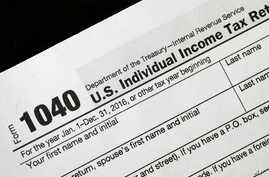 FILE - In this Jan. 10, 2017 file photo, a 1040 tax form appears on display in New York.