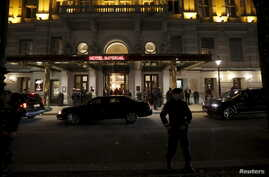An Austrian police officer stands outside Hotel Imperial in Vienna, site of talks on the Syrian crisis, Nov. 13, 2015.