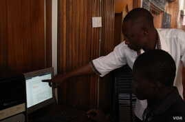 A computer instructor at Ahmadu Belo University in Zaria, Northern Nigeria takes first year student of archeology through the use of eGranary offline digital library use. The educational material is available to students at no cost, whether there is