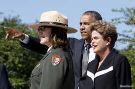 U.S. President Barack Obama and Brazil President Dilma Rousseff tour the Martin Luther King Jr. Memorial with a National Park ranger in Washington, June 29, 2015.