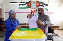 A Jordanian man casts his ballot at a polling station for parliamentary elections in Amman, Sept. 20, 2016