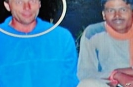 Italian national Claudio Colangelo (L)  is seen pictured with fellow Italian national Paolo Bosusco (R), who continues to be held hostage