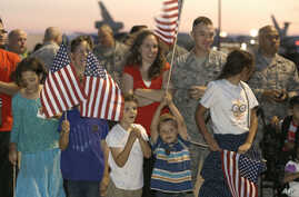 FILE - U.S. Air Force personnel and their families wait for the arrival of Airman 1st Class Spencer Stone, one of three Americans who tackled a heavily armed gunman on a Paris-bound train, at Travis Air Force Base in Fairfield, California, Sept. 3, 2