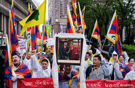 Activists hold Tibetan flags during a march to mark the 60th anniversary of Tibetan uprising against Chinese rule, in Taipei, Taiwan, March 10, 2019.