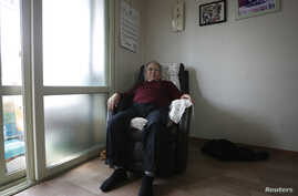 Jang Choon, 82, who was one of the participants in the latest inter-Korean reunion for families separated by the 1950-53 Korean War poses at his house in Namyangju, South Korea, March 9, 2014.