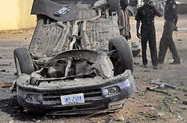 The wreckage of a car near the zonal police headquarters after a bomb attack in Nigeria's northern city of Kano.
