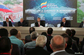 Venezuela's Vice President Tareck El Aissami (C) speaks during a meeting with bondholders and their representatives, next to Oil Minister Eulogio del Pino, Economy Vice President Wilmar Castro, Planning Minister Ricardo Menendez and Economy Minister