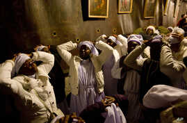 Christian pilgrims from Nigeria pray inside the Grotto of the Church of the Nativity, traditionally believed by Christians to be the birthplace of Jesus Christ, in the West Bank city of Bethlehem on Christmas Eve Wednesday, Dec. 24, 2014. (AP Photo/M