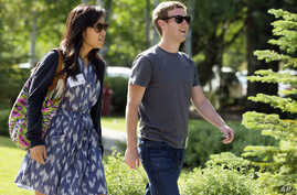 Mark Zuckerberg, president and CEO of Facebook, with his girlfriend Priscilla Chan during the 2011 Allen and Co. Sun Valley Conference, July 9, 2011, in Sun Valley, Idaho