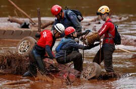 Members of a rescue team search for victims of a collapsed tailings dam owned by Brazilian mining company Vale SA in a vehicle on Paraopeba River, in Brumadinho, Brazil, Feb. 5, 2019.