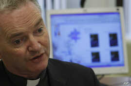 FILE - Monsignor Paul Tighe from the Vatican's Pontifical Council for Social Communications talks to the Associated Press during an interview, Dec. 18, 2009.