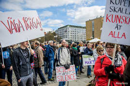 "Demonstrators hold placards during the ""March for Science Stockholm"" manifestation at Medborgarplatsen square in Stockholm, Sweden April 22, 2107."