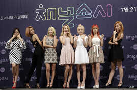 "Members of the South Korean girl group Girls' Generation pose for the media during a presentation to promote their new reality TV program ""Channel Girls' Generation"" in Seoul, South Korea, July 21, 2015."