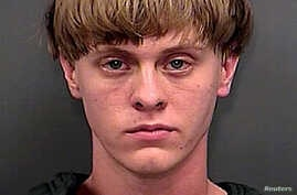 FILE - Dylann Roof is seen in this June 18, 2015 handout booking photo provided by Charleston County Sheriff's Office.  Courtesy of Charleston County Sheriff's Office.