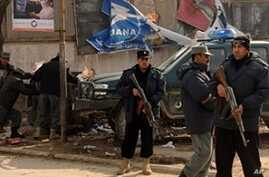 Afghan police stand guard at a site of a blast in the center of Kabul, 28 Nov 2009