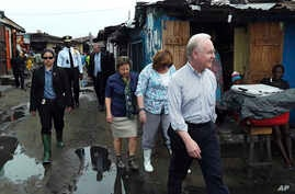 US Secretary of Health and Human Services Tom Price, right, walks  May 18, 2017 through a densely-populated and heavily congested Monrovia, Liberia, slum community which was quarantined in 2014 when Ebola struck there killing dozens.