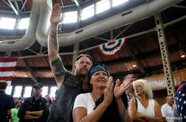 """People applaud a speaker as they wait for Republican nominee Donald Trump to speak at """"Joni's Roast and Ride"""" in Des Moines, Iowa, U.S., Aug. 27, 2016."""