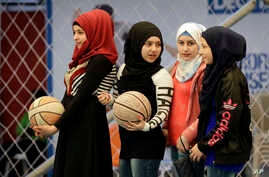 Syrian refugee girls attend a basketball training session at a private sports club, southern Beirut, Lebanon, Feb. 19, 2017.