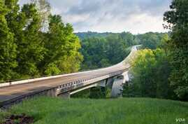 Highway 96 Double Arch Bridge soars 47 meters above Birdsong Hollow at milepost 438, in Tennessee, near the northern end of the Natchez Trace Parkway.