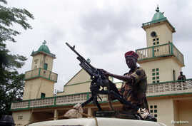 Soldiers from the Seleka rebel alliance stand guard as the Central African Republic's new President Michel Djotodia (not pictured) attends Friday prayers at the central mosque in Bangui, Mar. 29, 2013.
