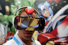A visitor tries the new Samsung Gear VR (virtual reality) device at the IFA consumer technology fair in Berlin, Germany, Sept. 5, 2014.
