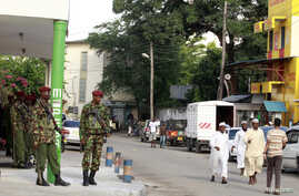 FILE - Members of the General Service Unit (GSU) stand guard along a street after assailants killed Muslim cleric Sheikh Mohammed Idris, chairman of the Council of Imams and Preachers of Kenya (CIPK), in the coastal port town of Mombasa, June 10, 201