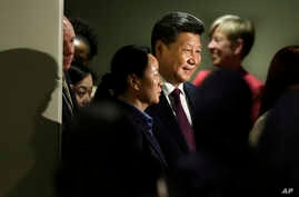 Chinese President Xi Jinping leaves a meeting on gender equality and women's empowerment at United Nations headquarters, Sunday, Sept. 27, 2015.