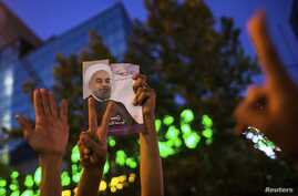Supporters of moderate cleric Hassan Rouhani celebrate his victory in Iran's presidential election, Tehran, June 15, 2013.